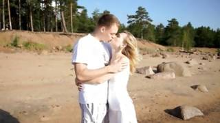Blonde slut is kissed by indecent man on beach