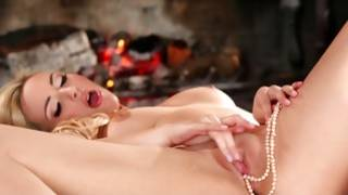 Light haired gorgeous slut is putting white pearls in her vagina