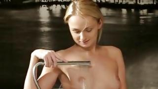 Bitchy babe is fingering below a water