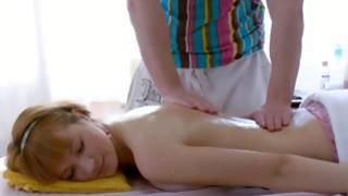 Seductive beauty is massaged on her stunning back
