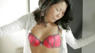Exotic asian slut showing her milk cans in a bra