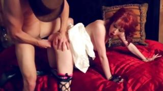 Red haired girl in her suit pounded from behind