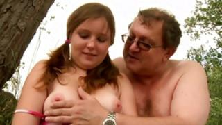 Old unsightly being having sexual intercourse in a countryside with some infant actress