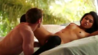 This attractive brown-haired is relaxing on a bed and feeling unique relish