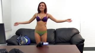Cheerful young slut looks sexy while nude on sofa