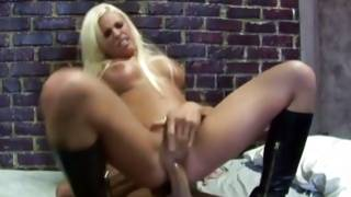 Strumpet in boots riding on a huge dick